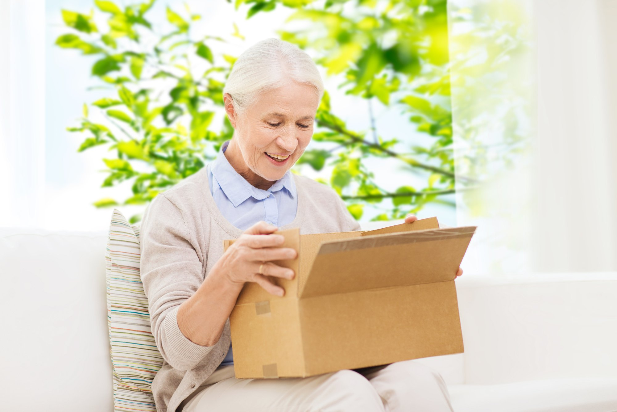Grandmother delighted to open a care package